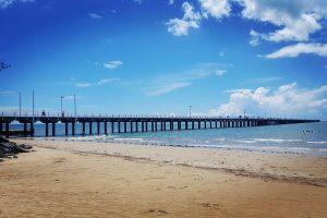 urangan pier in background of beach and sandy shore