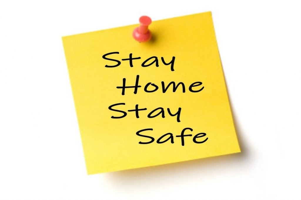 pinned yellow note Stay Home Stay Safe